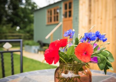 Morndyke Shepherds Huts Exterior with Vase of Flowers